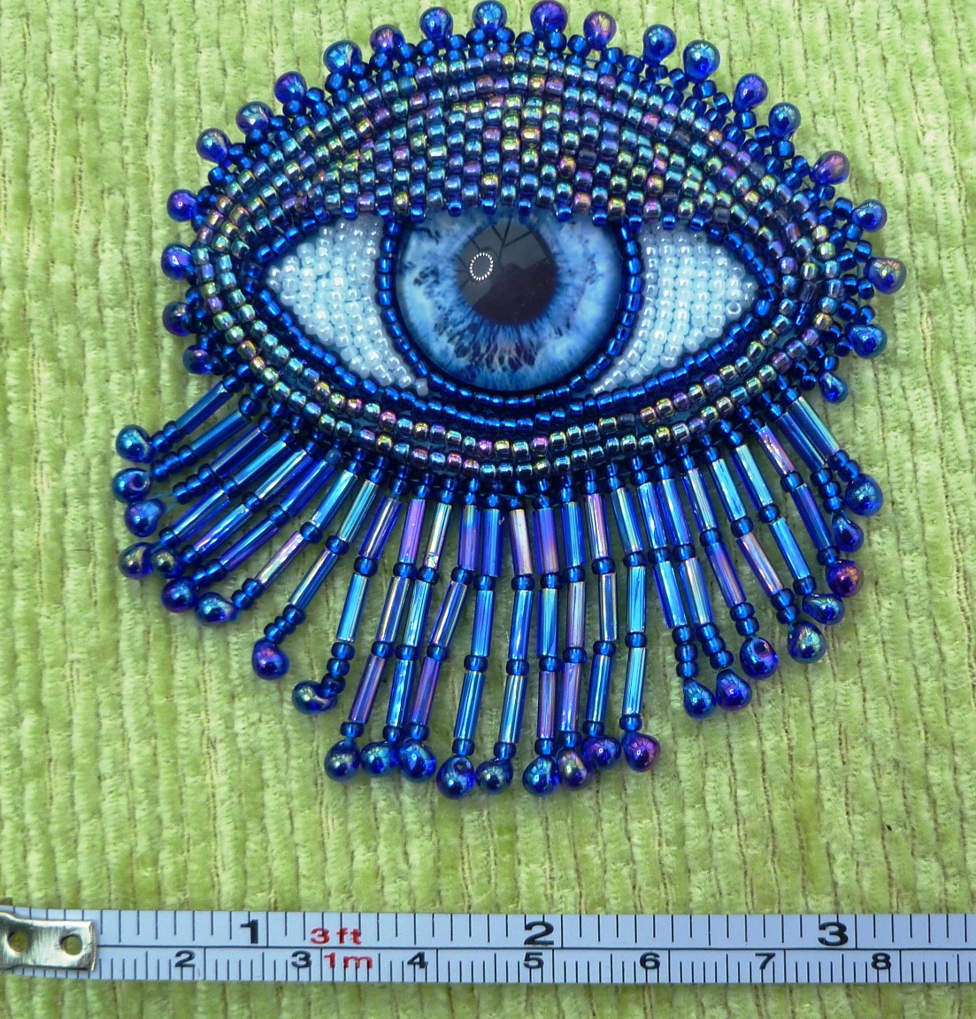 blue 'eye' brooch
