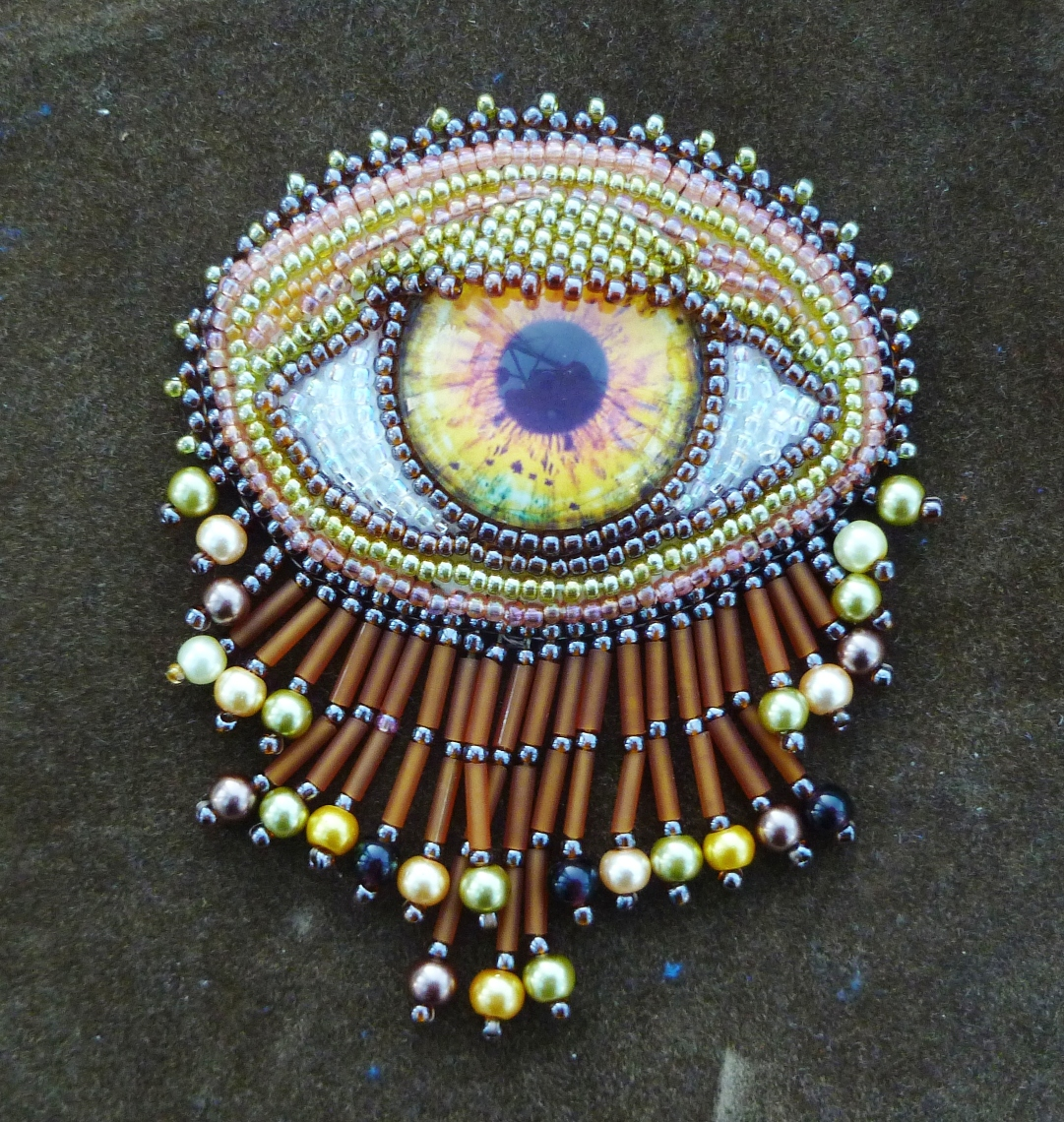 golden eye brooch